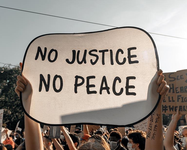 Protest sign: No Justice - No Peace