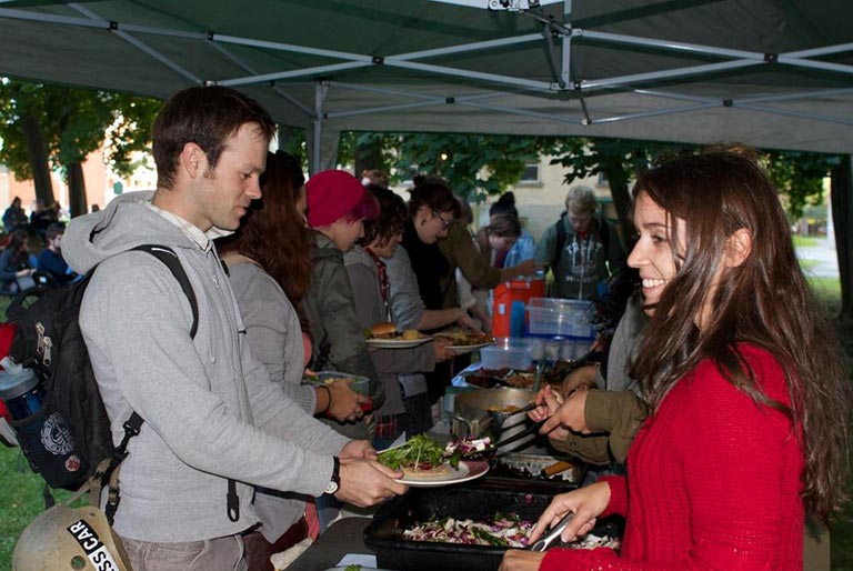 OPIRG Voluteers serving food at an outdoor public event