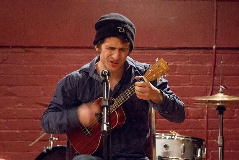 Musician playing at an OPIRG event at Sadleir House, Peterborough, Ontario